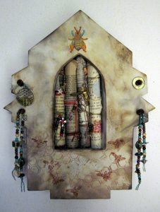 """Peaked embellished clay niche with rolled paper """"scrolls"""" embellished with beads and numerous """"bee"""" charms."""